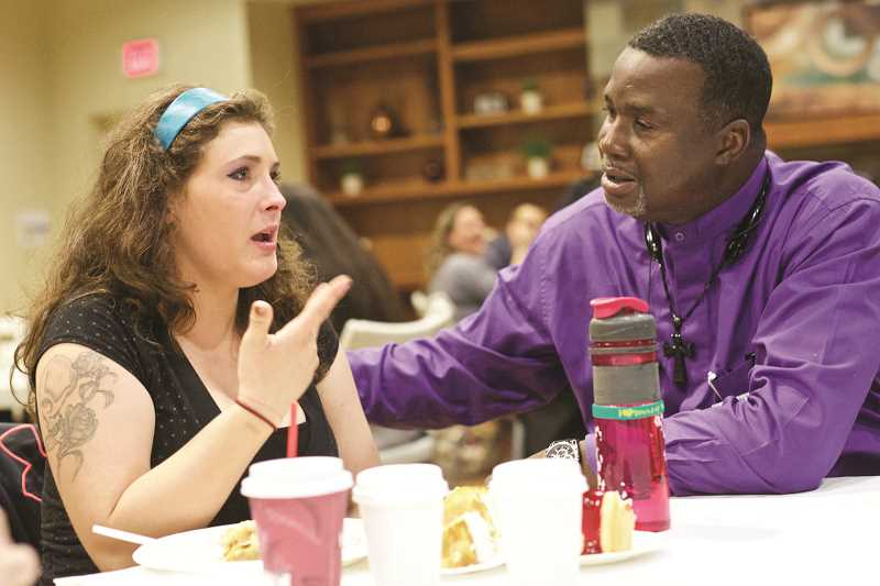 Amanda Hill of Aloha shares whats on her mind during mealtime before church service at Sonrise in Hillsboro.
