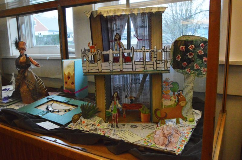SPOTLIGHT PHOTO: NICOLE THILL - A doll house designed by Giovanna Anderson, is one of the larger pieces on display at the St. Helens Public Library. At only 6 years old, Anderson was one of the youngest artists to submit a piece.