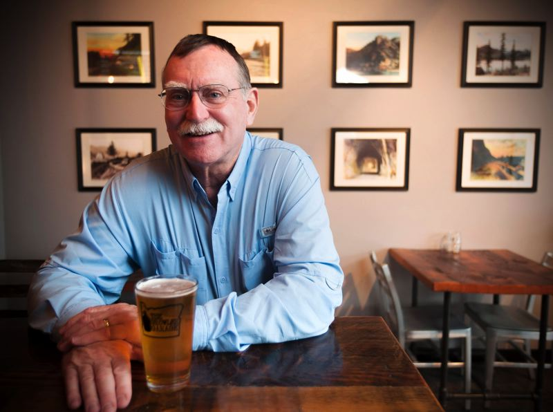 OUTLOOK PHOTO: JOSH KULLA - Gresham resident David Sell collects historic postcards and photographs of Oregon highways and scenic areas. He has donated a large number of prints to the Growler Garage, where he has a longstanding friendship with owner Ryan Thompson.