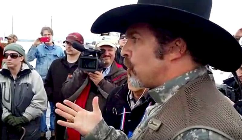 COURTESY OF THE PETE SANTILLI SHOW - With others looking on, Pete Santilli talked with FBI and law enforcement outside Harney County's airport, asking them to leave the county. FBI officials politely declined his request.