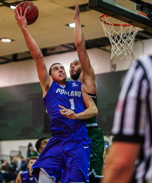 TRIBUNE FILE PHOTO: DIEGO G. DIAZ - Bryce Pressley (left) of the Portland Pilots goes to the basket against Portland State's Cameron Forte.