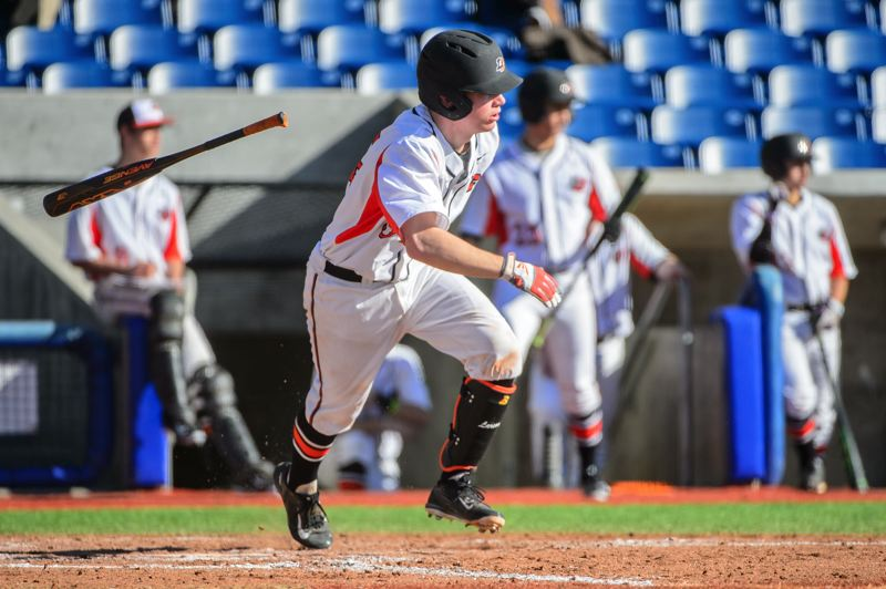 COURTESY: CHRISTOPHER OERTELL - Cooper Larson of Lewis & Clark College heads to first base at Ron Tonkin Field.