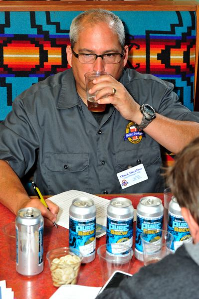 COURTESY: CLEAN WATER SERVICES  - A judge tastes a beer brewed for the 2015 Pure Water Brew competition sponsored by Clean Water Services, the Washington County sewer and storm drainage utility. Clean Water Services made treated, purified water available to home brewers for the competition.