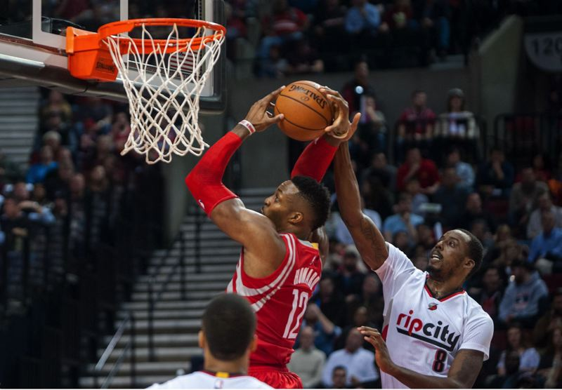 TRIBUNE PHOTO: DIEGO G. DIAZ - Portland's Al-Farouq Aminu goes up to deter Dwight Howard of Houston close to the basket in the Trail Blazers' victory Wednesday night at Moda Center.