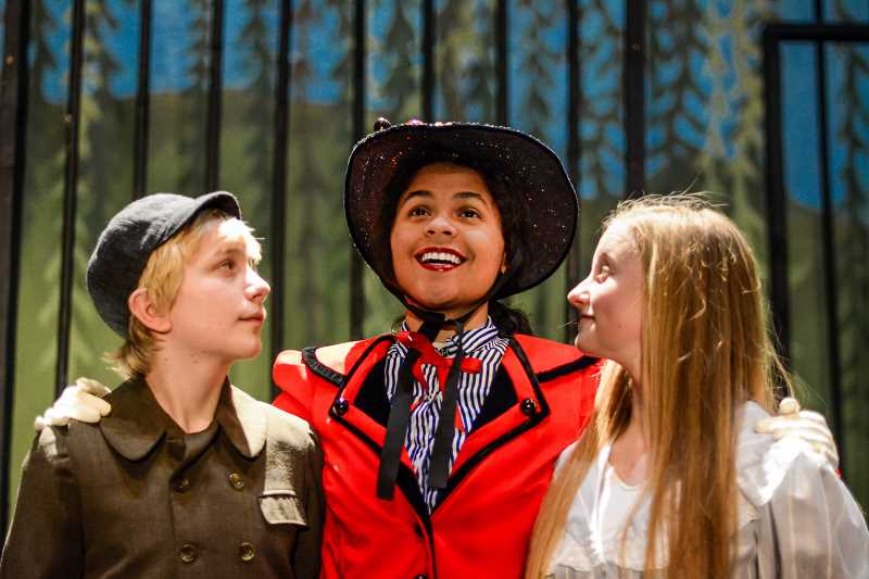 COURTESY PHOTO - Left to right, Kevin Carrigan, Sahara Defrees and Hannah Burke are Michael, Mary Poppins and Jane in Liberty High Schools production of Mary Poppins.