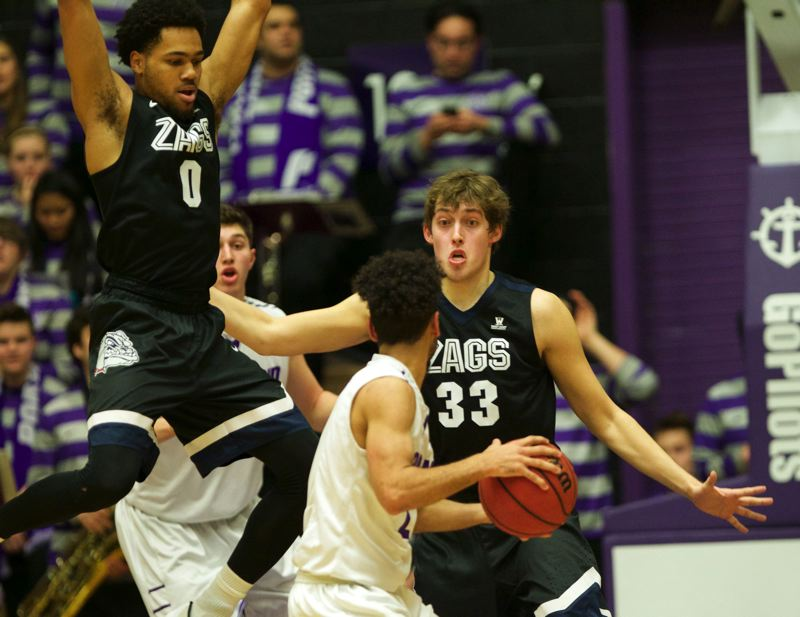 TRIBUNE PHOTO: JAIME VALDEZ - Gonzaga Bulldogs guard Silas Melson (left) and forward Kyle Wiltjer (right) defend Portland Pilots guard Alec Wintering during Thursday's game at Chiles Center.