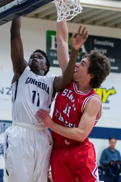 COURTESY: CHRISTOPHER OERTELL - Concordia guard Dennis Ahana (left) goes inside against Simon Fraser.