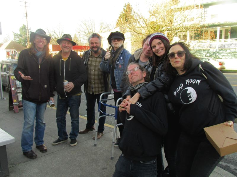 PAMPLIN MEDIA GROUP: SHANNON O. WELLS - From left, Dave Reisch, Christopher Webster, Tracy Lowman, Lewi Longmire and Fernando Viciconte commiserate outside the LaurelThirst Public House over the recent loss of Jim Boyer, their longtime friend and musical collaborator.