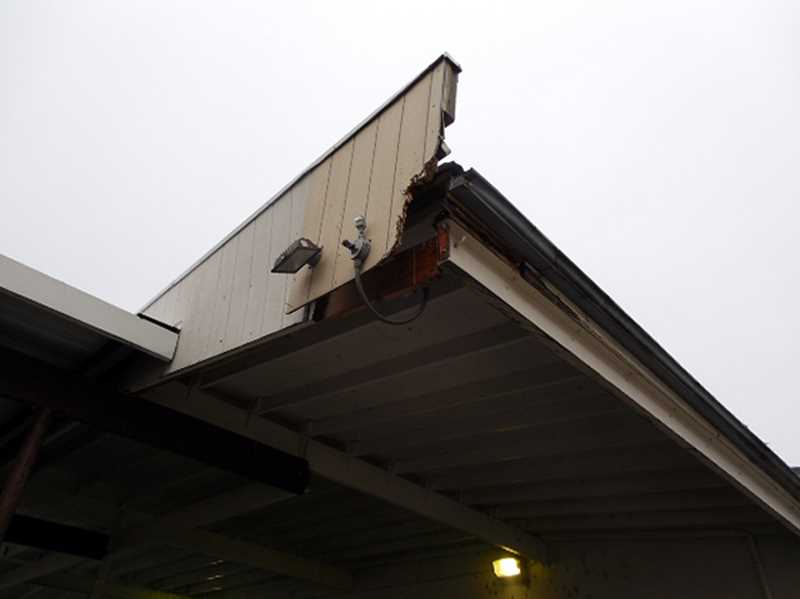 COURTESY PHOTO: JAMES FRANCISCO, USPS CONSUMER & INDUSTRY CONTACT MANAGER - Damaged interior and exterior walls and awnings -- which have exposed electrical wiring -- are just a few of the maintenance repair needs at the ailing Forest Grove Post Office.