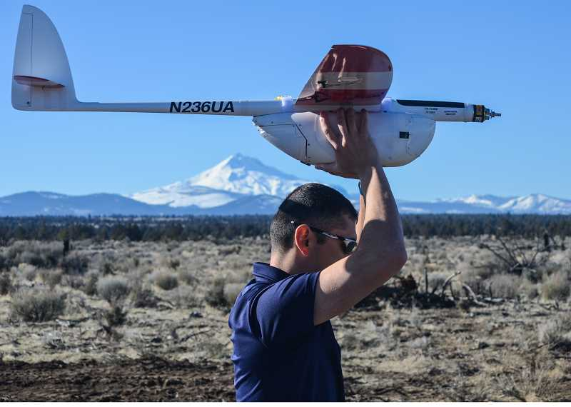 SUBMITTED PHOTO - Tom Normandy, test range manager for the Confederated Tribes of Warm Springs' Eagle Tech Systems, gets ready to launch the Aeromapper during a recent demonstration.