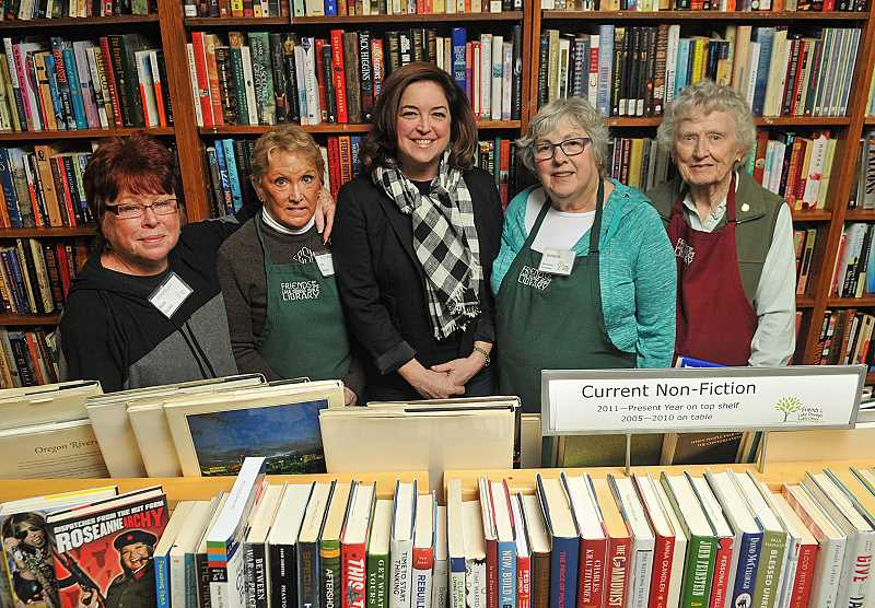 REVIEW PHOTO: VERN UYETAKE - Nancy Niland, president of Friends of the Lake Oswego Library, credits the organization's volunteers for making Booktique one of the most unique bookstores in the Portland area. From left: Rhonda Allen, Essie Smith, Niland, Barbara Gold and Melba Stiles.