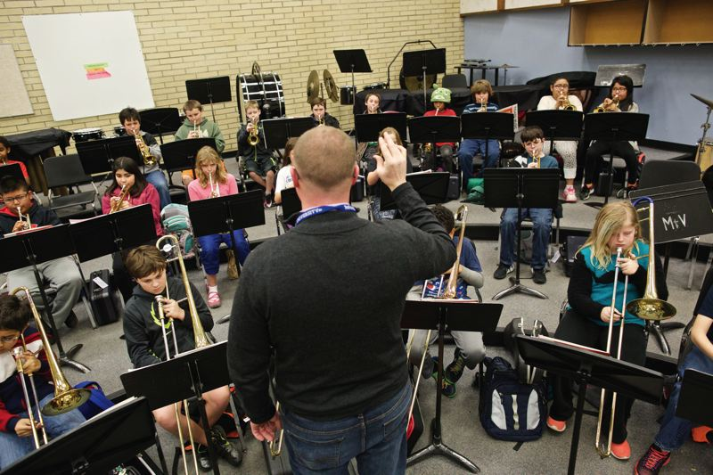 TIMES PHOTO: JAIME VALDEZ - Fifth-graders that were bused in from their elementary schools play their instruments during band practice at Mountain View Middle School.