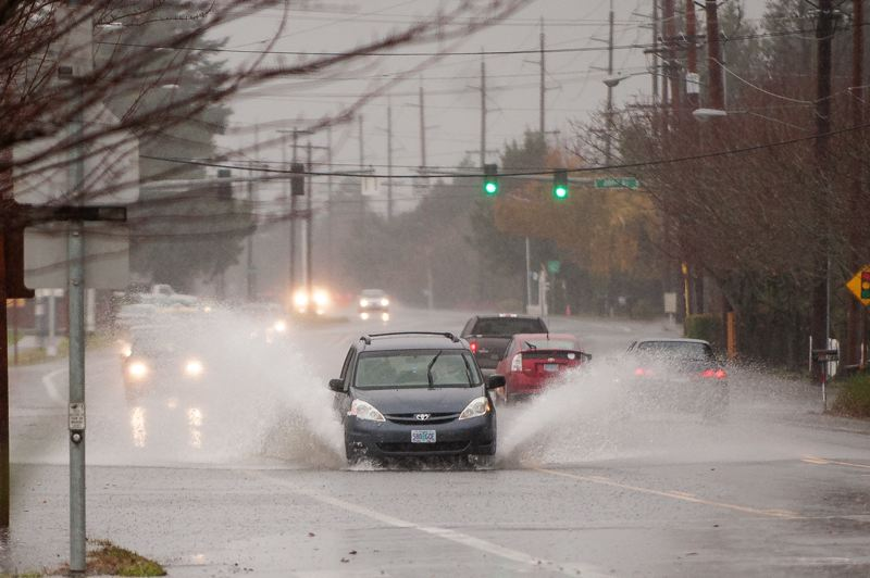 PAMPLIN MEDIA GROUP FILE PHOTO - High water spilled onto Gresham streets during the early December storms. President Obama has signed a disaster declaration for 12 Oregon counties, including Multnomah, that were hit by the storms.
