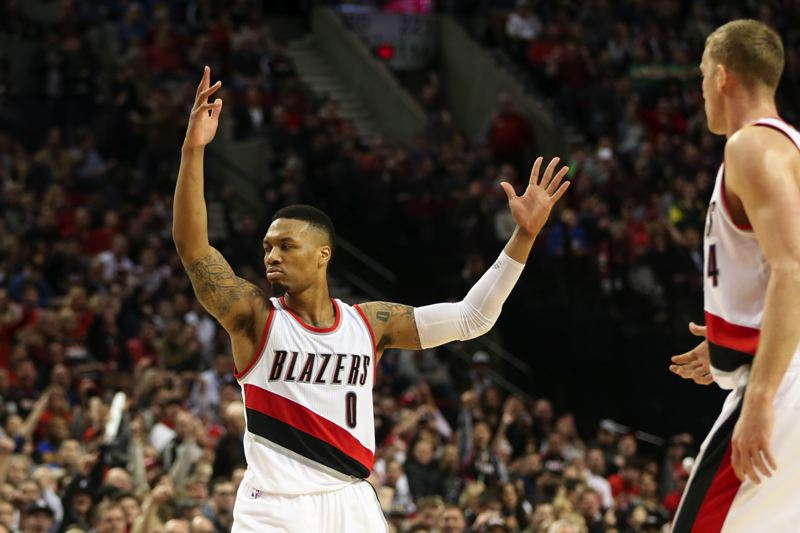 TRIBUNE PHOTO: DAVID BLAIR - Damian Lillard responds to the crowd after another shot goes down in his 51-point night Friday against Golden State.