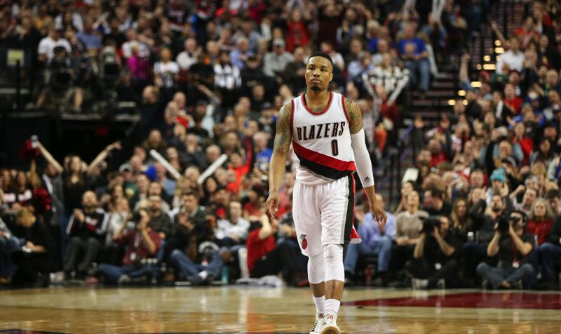 TRIBUNE PHOTO: DAVID BLAIR - Damian Lillard seemingly has the floor to himself as he leads the Trail Blazers past the Golden State Warriors on Friday night at Moda Center.