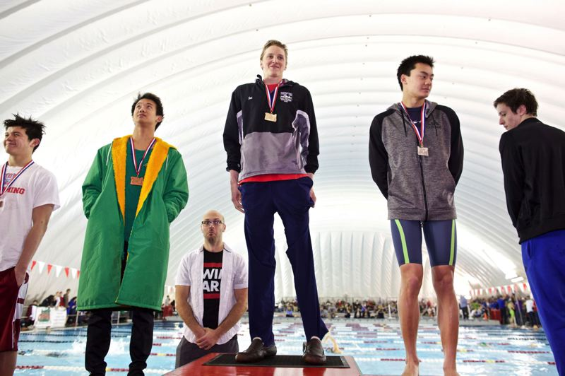 TRIBUNE PHOTO: JAIME VALDEZ - Sid Farber (center) of Lincoln High is on the winner's stand after one of his two freestyle victories Saturday at the Class 6A championships at Mt. Hood Community College. Cleveland's Tyler Soo (second from left) placed third in the 50 free.