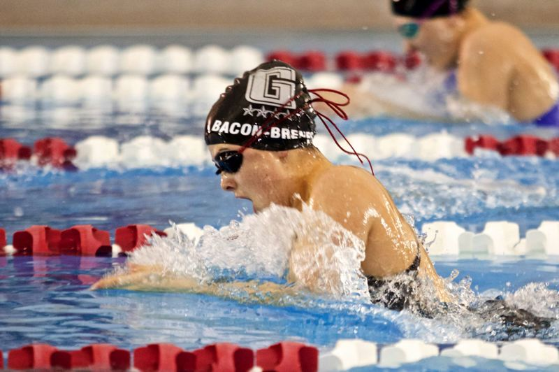 TRIBUNE PHOTO: JAIME VALDEZ - Grant's Claire Bacon-Brenes competes in the 100-yard breaststroke at Mt. Hood Community College.