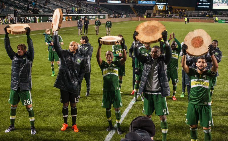 TRIBUNE PHOTO: DIEGO G. DIAZ - Portland Timbers players celebrate after Sunday night's 4-0 home victory over Minnesota United.