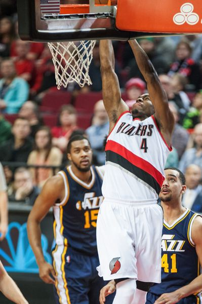 TRIBUNE PHOTO: JOSH KULLA - Moe Harkless, Blazers forward, goes to the basket against Utah on Sunday night.