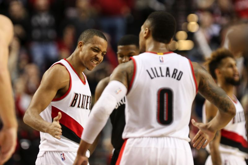TRIBUNE PHOTO: DAVID BLAIR - Guards CJ McCollum (left) and Damian Lillard exchange congratulations en route to their total of 68 points in Tuesday's Trail Blazers win at home over the Brooklyn Nets.