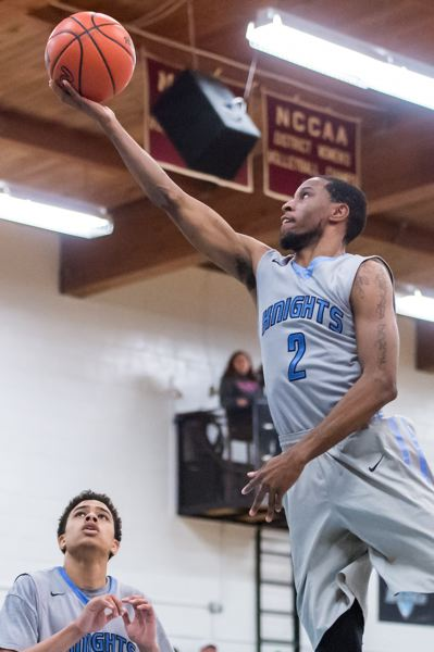 COURTESY: CHRISTOPHER OERTELL - Taylor Young goes up with a finger roll for Warner Pacific as the Knights defeat visiting Eastern Oregon 80-71 on Wednesday.