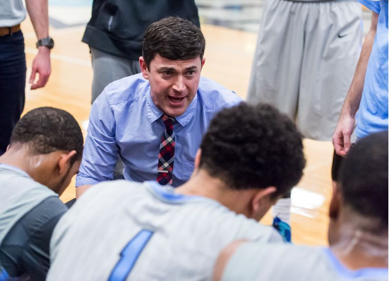 COURTESY: CHRISTOPHER OERTELL - Warner Pacific College men's basketball coach Jared Valentine talks to his team during a timeout.