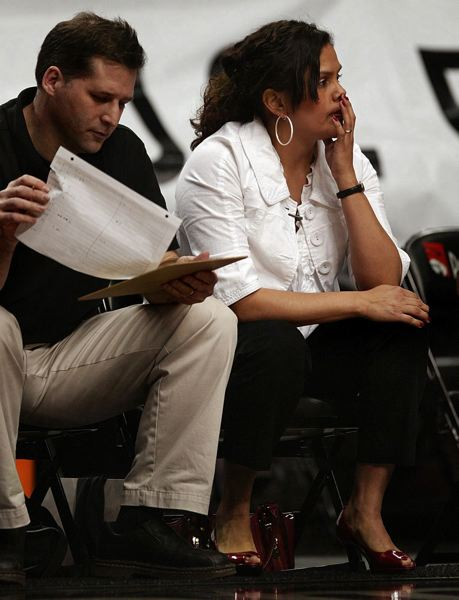 TRIBUNE FILE PHOTO: L.E. BASKOW - While serving as Franklin High girls basketball coaches in 2010, Ceci Moses (right) and Rick Schimmel watch the Quakers take on Jesuit.