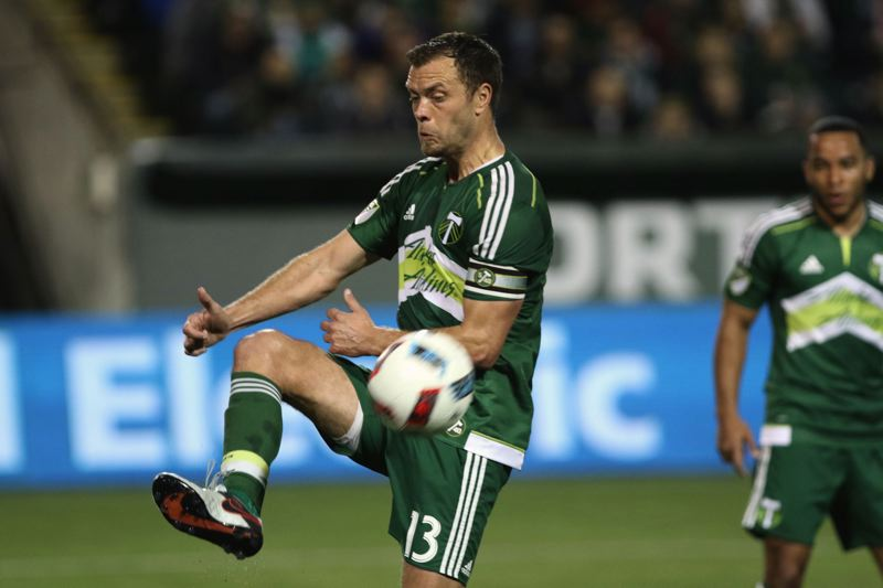 TRIBUNE PHOTO: JAIME VALDEZ - Portland Timbers defender Jack Jewsbury kicks away a Vancouver Whitecaps corner kick.