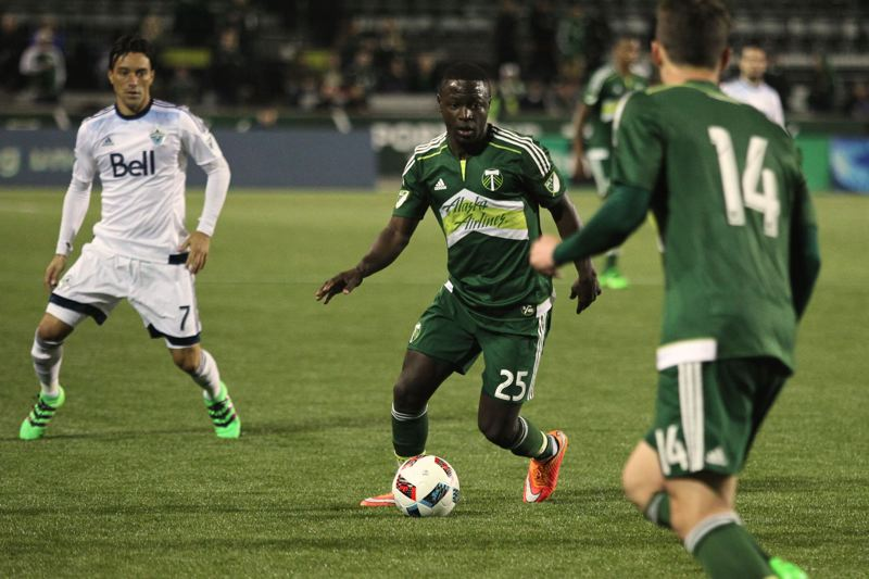 TRIBUNE PHOTO: JAIME VALDEZ - Portland Timbers forward Neco Brett (25) looks to pass to a teammate against the Vancouver Whitecaps .