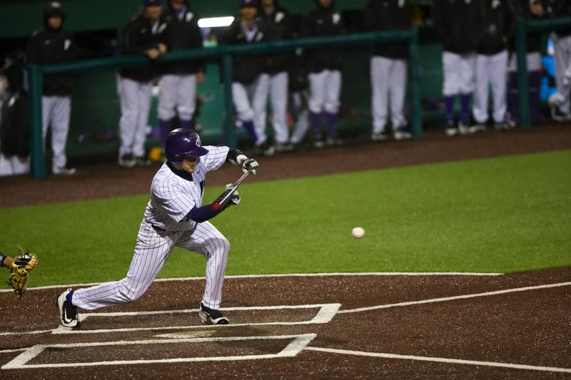 COURTESY: UNIVERSITY OF PORTLAND - Senior Kevin Farley bunts for the Portland Pilots in their 10-7 victory Friday night at Joe Etzel Field.