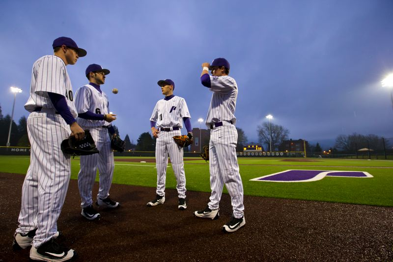 COURTESY: UNIVERSITY OF PORTLAND - Portland Pilots (from left) Cody Hawken, Caleb Whalen, Michael Forgione and Ryan Barr confer before the start of the first night game at Joe Etzel Field. UP won 10-7 in the series opener against Oakland.