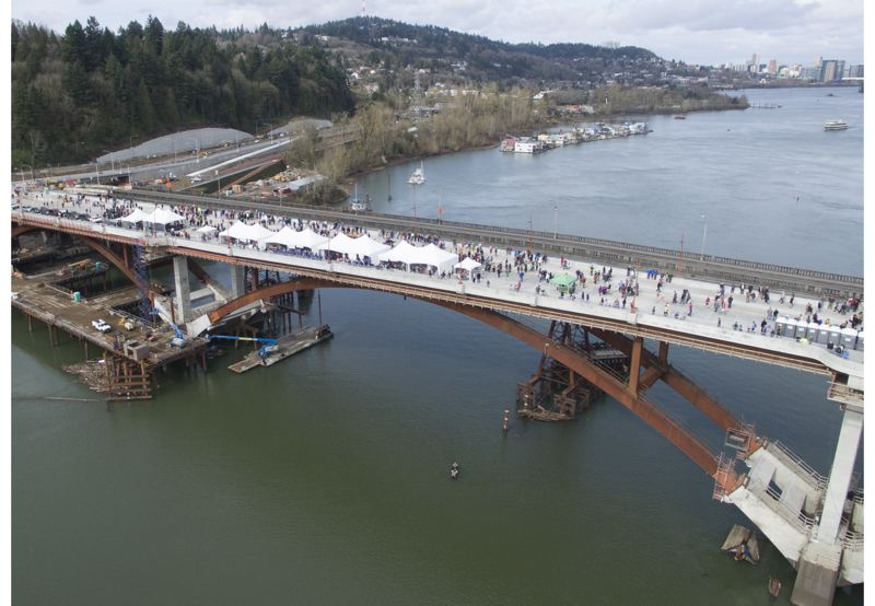 TRIBUNE PHOTO: ALVARO FONTAN - A drone's view of the new $317 million Sellwood Bridge shows Saturday's opening celebration. The bridge will open to traffic Tuesday, March 1.