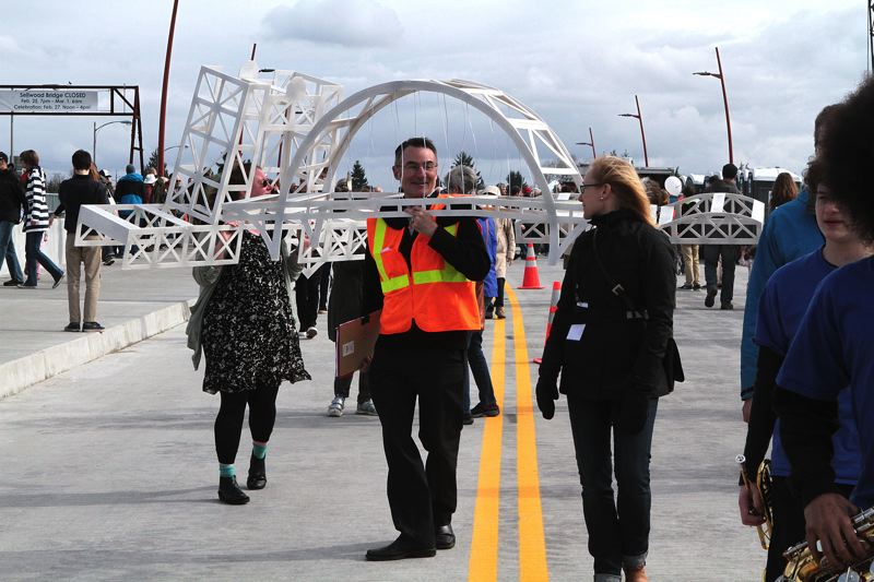 TRIBUNE PHOTO: DAVID ASHTON - Multnomah County spokesman Mike Pullen wore a Fremont Bridge costume Saturday to celebrate the new Sellwood Bridge opening.