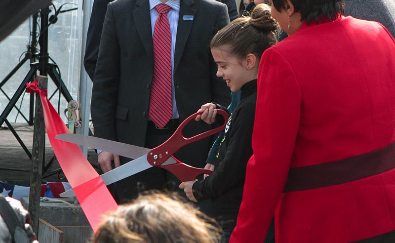 TRIBUNE PHOTO: DAVID ASHTON - Anna Blosser cut the ribbon to open the new Sellwood Bridge Saturday afternoon.