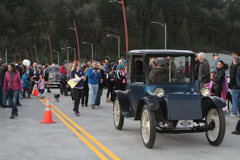 TRIBUNE PHOTO: DAVID ASHTON - A Milburn Light electric car led a parade of vintage vehicles Saturday afternoon to open the new $317 million Sellwood Bridge.