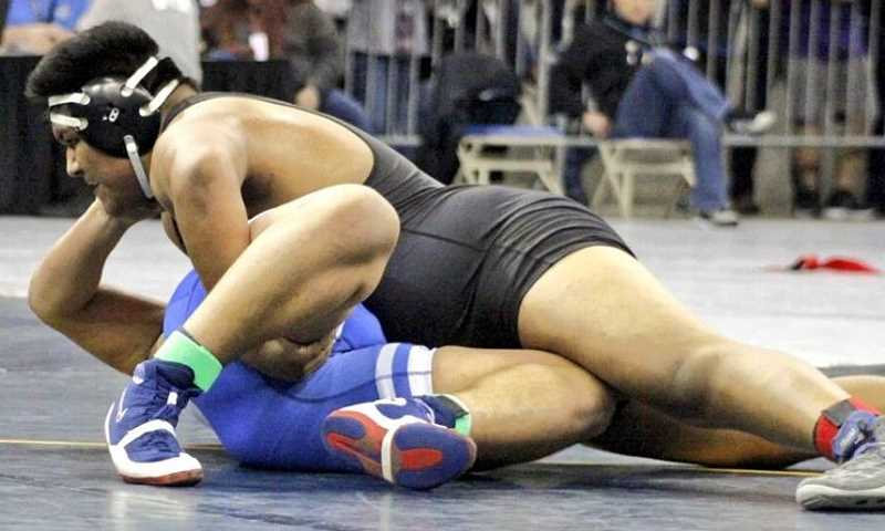 COURTESY PHOTO: AMY GADBOIS - Lions junior Miguel Olmedo pinned eighth-ranked South Albany senior Dexter Rimer in 3:50 for fifth at the OSAA Class 5A Wrestling State Championships on Saturday at Veterans Memorial Coliseum in Portland.