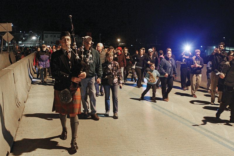 TRIBUNE PHOTO: DAVID F. ASHTON - A bagpiper led the procession one last time across the Sellwood Bridge.