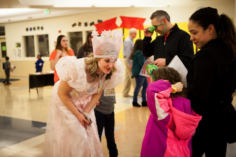 OUTLOOK PHOTO: ADAM WICKHAM  - A Butler Creek Elementary School student stops Glinda the Good Witch, aka Sarah Sipple, Butler Creek's literacy coach, for a chat.
