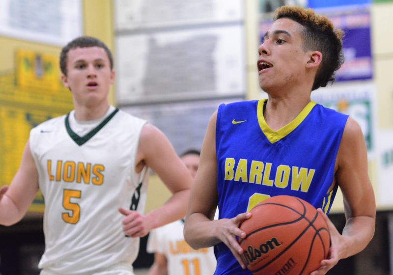 THE OUTLOOK: DAVID BALL - Barlows Leonard Dixon rushes down the court on a fastbreak.