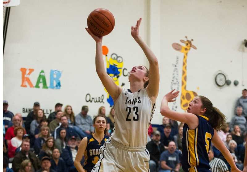 NEWS-TIMES PHOTOS: KENT FRASURE  - Banks' Anna Klein takes a shot during the Braves' 53-32 win over Stayton Friday night.
