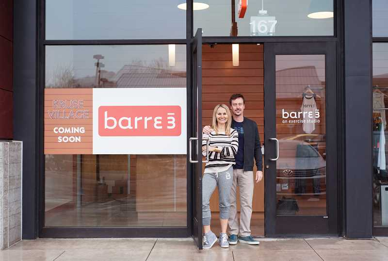 SUBMITTED PHOTOS  - Sadie and Chris Lincoln stand at the door of their newest barre3 fitness studio, located in Kruse Village in Lake Oswego.