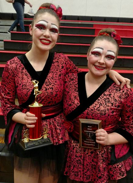PHOTO COURTESY OF JO ELLEN PACHELBEL - Emma Agger and Hailee Nunn, both seniors at Scappoose High School, hold two awards given to the Scappoose Vision Dance team on Saturday, March 5.