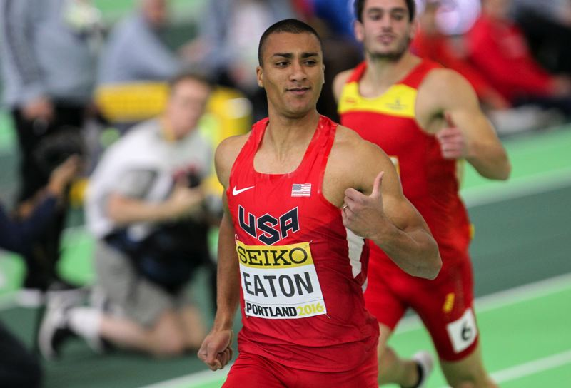 TRIBUNE PHOTO: DAVID BLAIR - Ashton Eaton crosses the line first in the men's 60 meters during Friday's heptathlon at the Oregon Convention Center. Eaton got off to a fast pace in the IAAF World Indoor.