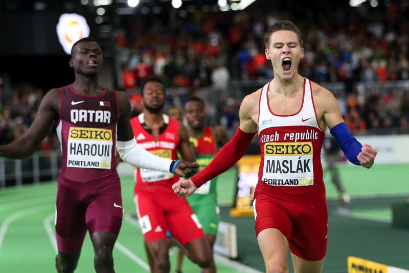TRIBUNE PHOTO: DAVID BLAIR - Pavel Maslak (right) of the Czech Republic wins the 400 meters Saturday night at the IAAF World Indoor in the Oregon Convention Center.