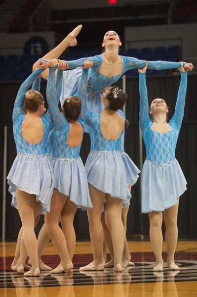 PAMPLIN MEDIA GROUP PHOTO: JOSH KULLA - Lauren Jacobs floats with the help of her Lakeridge teammates during the state dance and drill competition in Portland.