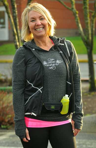 SPOKESMAN PHOTO: VERN UYETAKE - Sole Sisters founder Jules Moody is ready for one of the group's Saturday morning outings in Wilsonville.