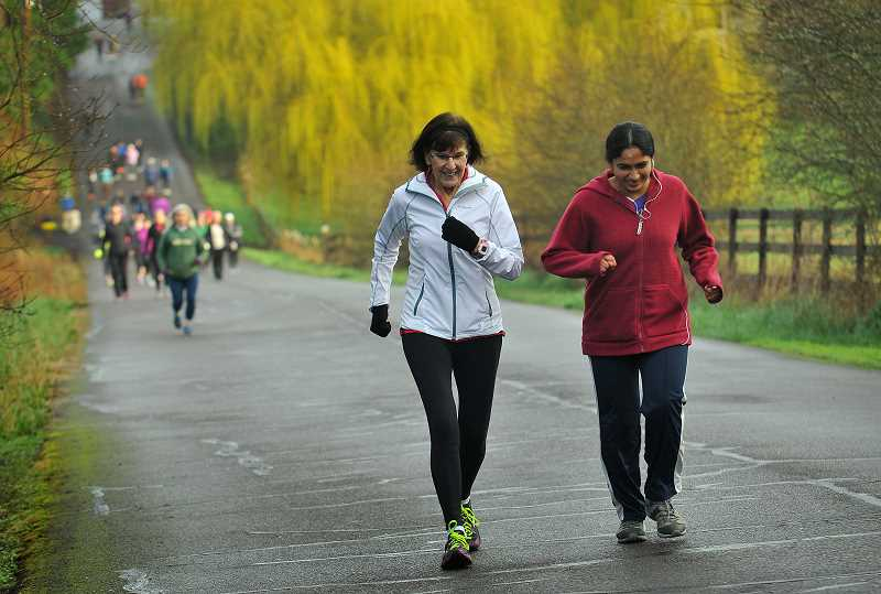 SPOKESMAN PHOTO: VERN UYETAKE - Dolores Scott and Swapna Gajjala enjoy the scenery during a recent walk with the Sole Sisters.