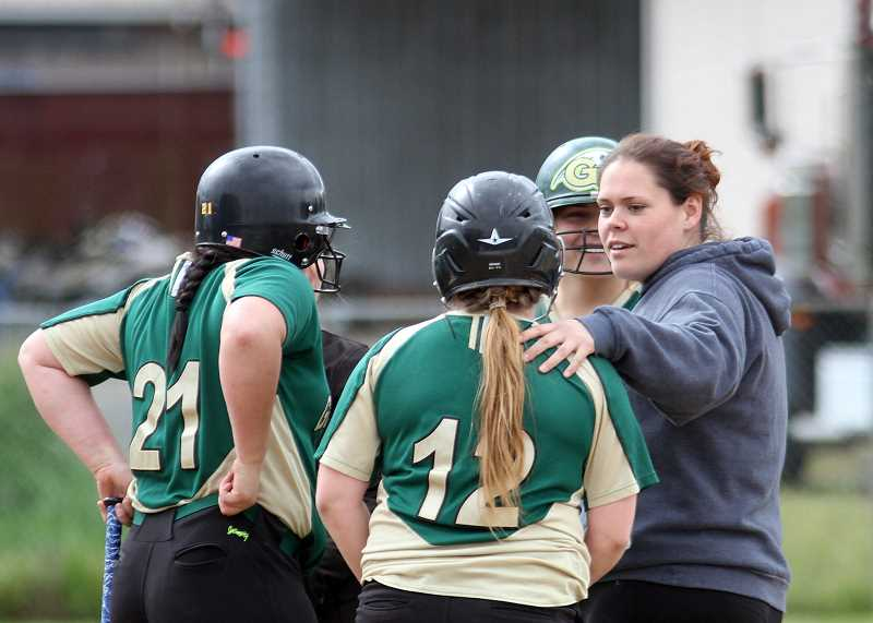 NEWS-TIMES PHOTO: AMANDA MILES - Kristin Larkins, shown at right in this 2015 file photo, moves up from assistant to head coach for Gaston softball this spring. She will try to steer a young roster back into the state playoffs.
