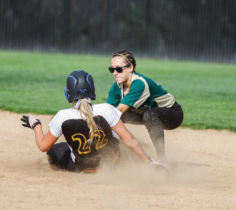 NEWS-TIMES PHOTO: CHASE ALLGOOD - Julia Clark tries to apply a tag at second base during a 2015 Gaston softball game. Clark opened her sophomore season up hitting at a .500 clip.
