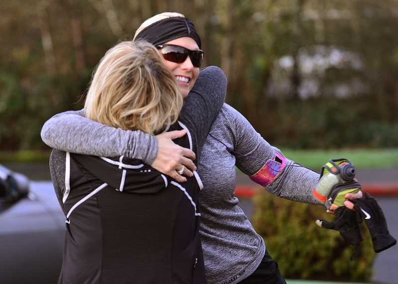 SPOKESMAN PHOTO: VERN UYETAKE - Jules Moody, left, and Julie Duvall greet each other before a walk with the Sole Sisters.